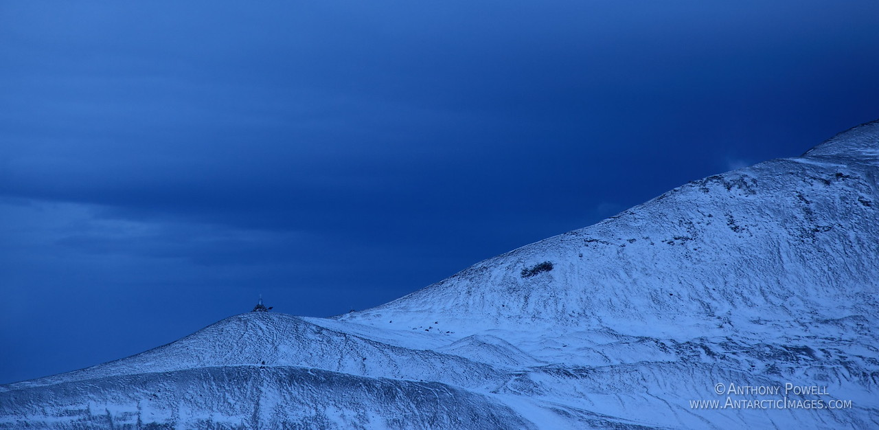 Hut point ridge to the north of McMurdo Station after a fresh snow fall a few days after the last sunset.