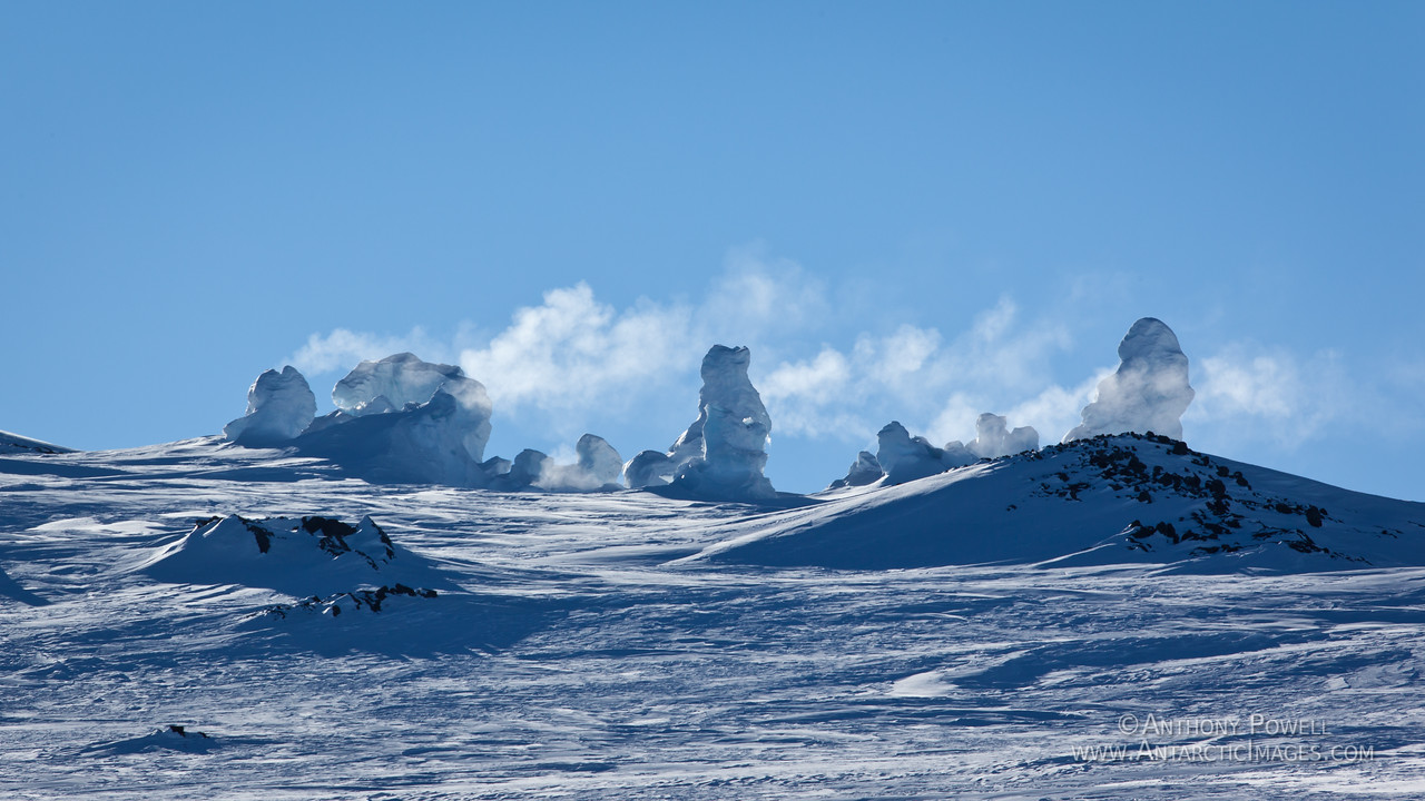 Ice fumaroles near the summit of Mount Erebus. Steam coming out of volcanic vents in the ground freezes as it hits the cold air, creating chimneys of ice.