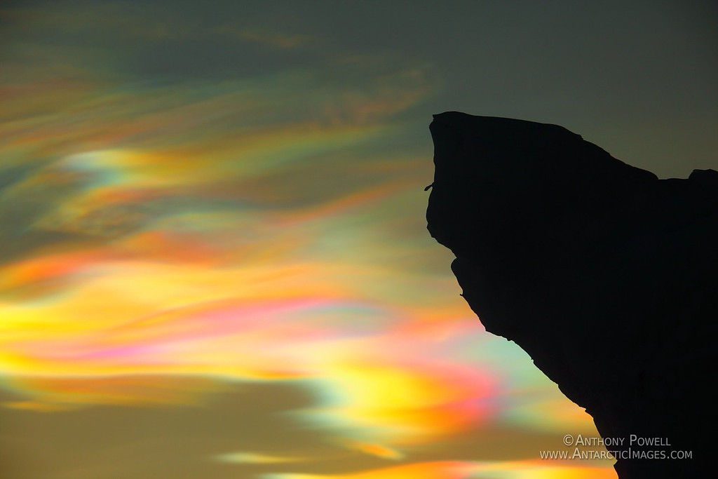 Nacreous or Polar Stratospheric Clouds in the sky above an ice formation in the Scott Base pressure ridges.