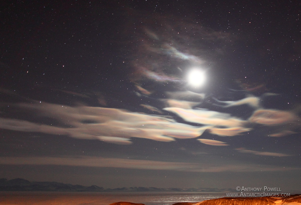 Nacreous or Polar Stratospheric Clouds being illuminated by the moon over McMurdo Sound Antarctica.