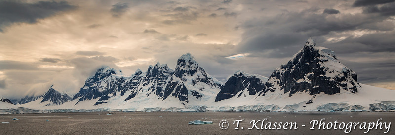 Scenic landscape of mountains and glaciers in the Neumayer Channel of the Antarctic Peninsula.