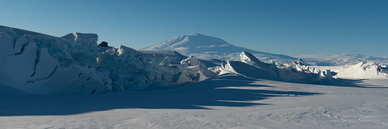 The sea ice pressure ridges in front of Scott Base in early summer. Mt Erebus in the background.