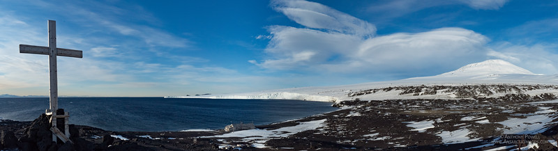 Cape Evans in late summer with open water. Barne Glacier in the distance and Mt Erebus to the right.
