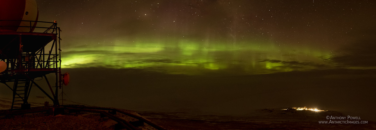 Auroras light up the clouds above Scott Base.