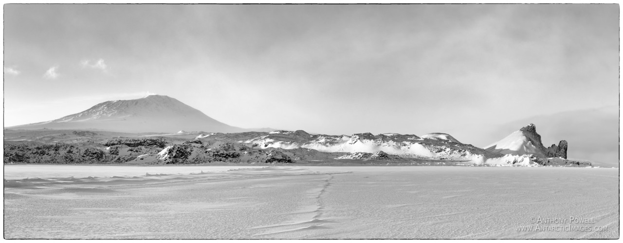 Mount Erebus as seen from the sea ice of McMurdo Sound in late winter as the sun returns. B&W