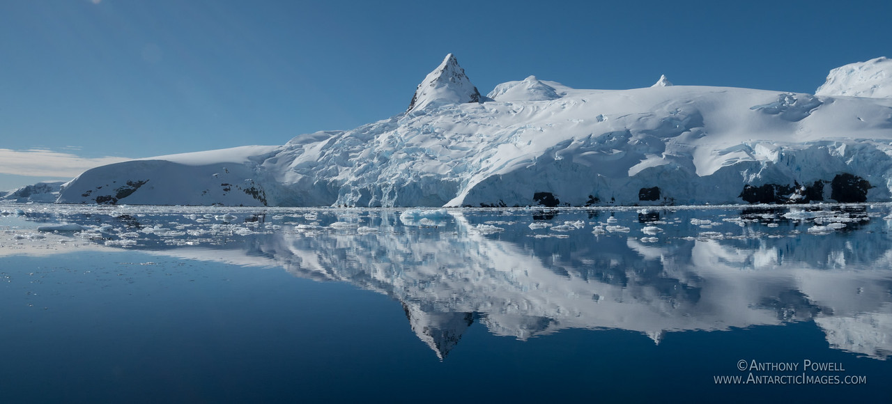Reflections in the calm waters of the Antarctic Peninsula as seen from the deck of the Lindblad Nat Geo Orion.