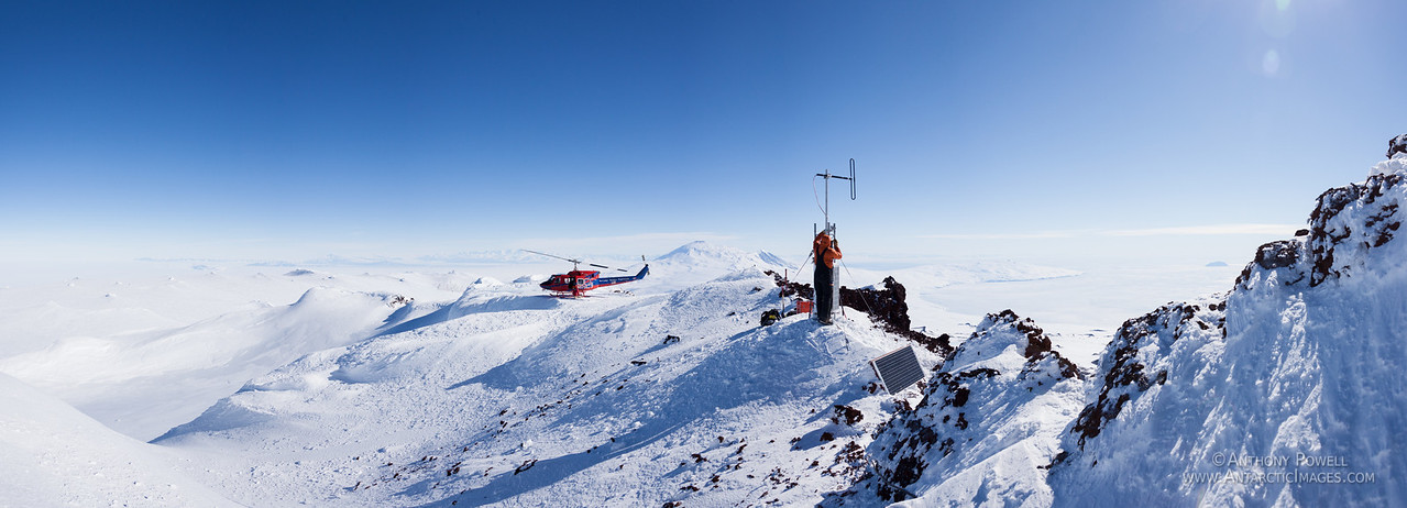 Working on the radio repeater on top of Mount Terror at the eastern end of Ross Island. Mount Erebus is to the west in the background.