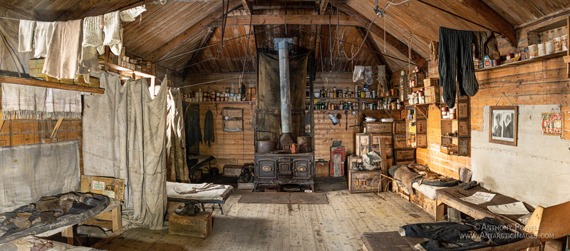 Inside Shackleton's historic hut at Cape Royds, Antarctica. From his historic 1907 Nimrod expedition. Panoramic photo taken in early September when the spring sun is still low on the northern horizon.