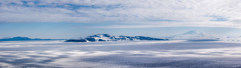 Black Island as seen from Minna Bluff. Brown Peninsula is on the left, Mount Erebus on the right.