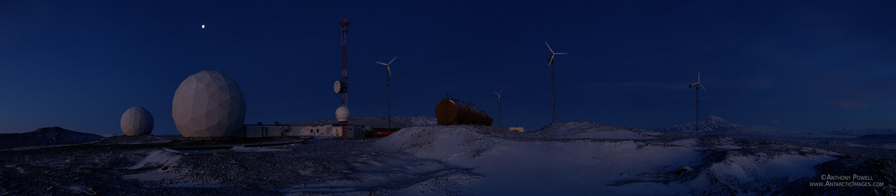 Black Island Satellite Station in the winter twilight. The wind turbines provide about 25% of the power needed to keep the station running.