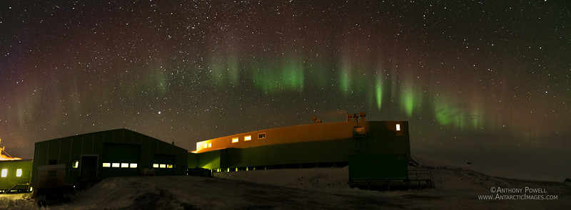 Picket fence aurora above the Hillary Field Center building at Scott Base.