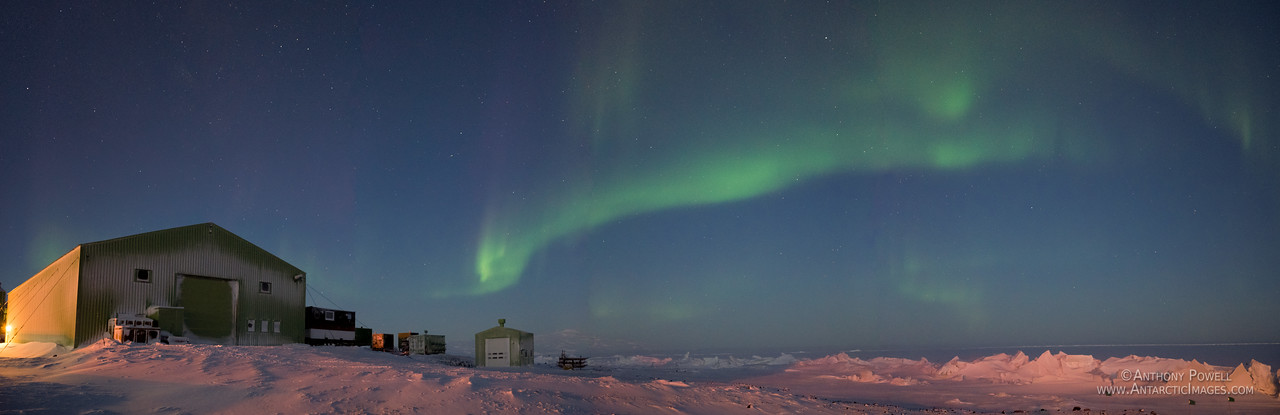 The Hangar building at Scott Base with an aurora australis over the sea ice pressure ridges.
