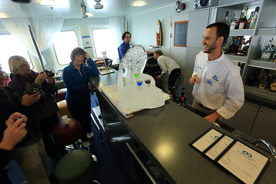 """Antarctica - Jan 2013 - Sergey Vavilov Circle Trip, The One Ocean Expedition staff: """"Gus"""" Guller Frers (Bartender) and his ice creation for Happy Hour."""