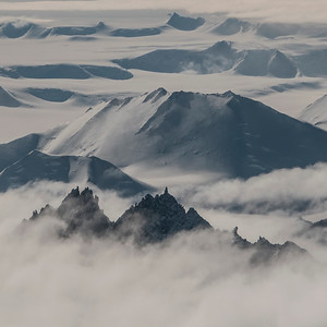 Misty peaks above the Nimitz Glacier, Ellsworth Mountains, Antarctica