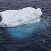 "A ""growler"" iceberg.  Smaller icebergs are known as either ""bergy bits"" or ""growlers"";  both originate from either glaciers or shelf ice.  Growlers are smaller fragments of ice and are roughly the size of a truck or grand piano.  A bergy bit is a medium to large fragment of ice; it's height is generally greater than three feet (one meter) but less than 16 feet (five meters) above sea level.<br /> <br /> Note that approximately 87% of the ice formation is under the water surface [actual % is related to the specific  gravities of the surrounding water and the iceberg's water (differing fresh water vs salt water)]."