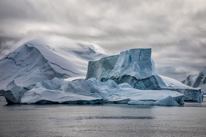 Dramatic Iceberg with Glacier Backdrop