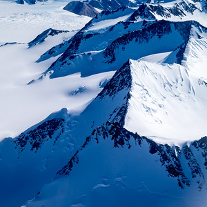 The Trans-Antarctic Mountain range, an extension of the South American Andres and the Australian Eastern Range, formed in the early days of the Gondwana supercontinent several hundred million years ago.  Today it composes most of the 3% of Antarctica that is not covered by a multi-kilometer tick sheet of ice.