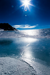 Antarctica is clear skies that, in summertime, allow the blazing 24-hour Sun to reflect off of the ice mirror.