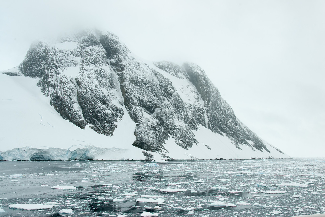 Snow covered mountain in Lemaire Channel, Antarctica