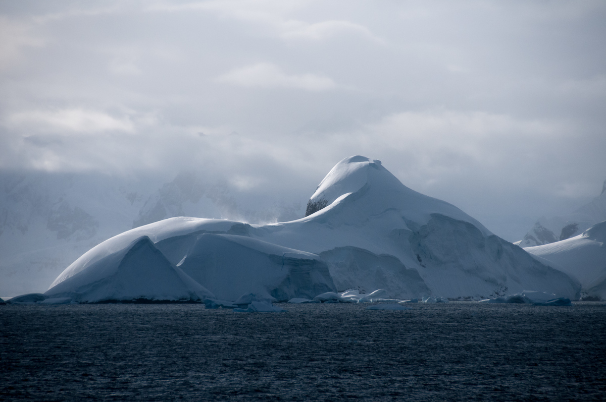 Snow Covered Mountains in the Lemaire Channel, Antarctica