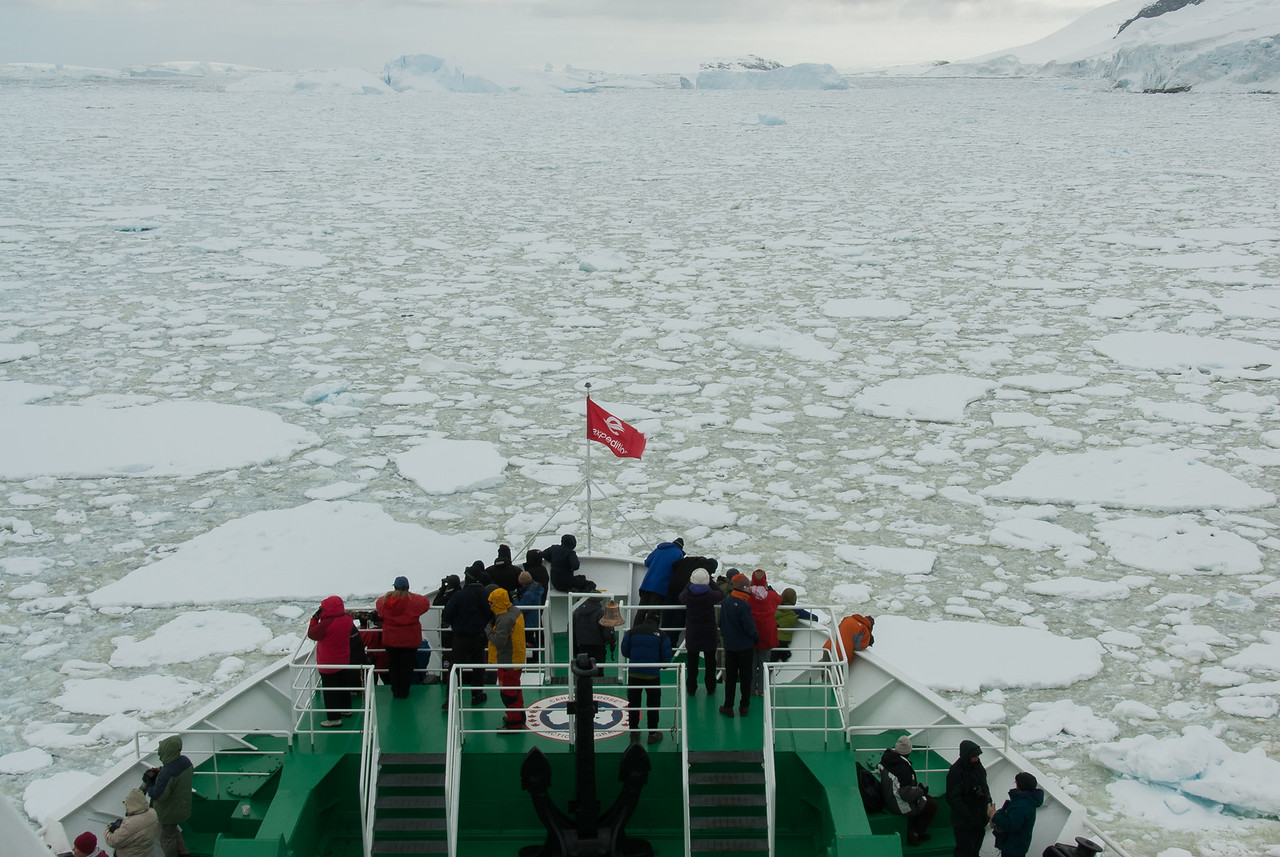 The bow of the M/S Expedition cutting through pack ice in the Lemaire Channel