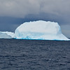 One of the first icebergs we see on our 26 day expedition, in the seas  to the northwest of South Georgia