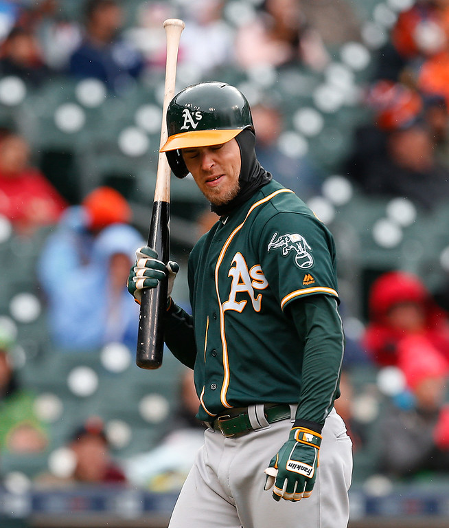 . Oakland Athletics\' Josh Reddick hits his helmet with his bat after striking out against the Detroit Tigers in the ninth inning of a baseball game in Detroit, Thursday, April 28, 2016. (AP Photo/Paul Sancya)
