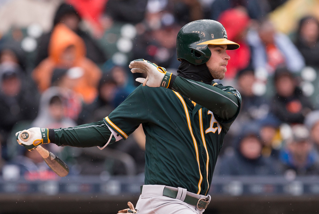 . Oakland Athletics\' Josh Reddick hits a one-run single in the third inning of a baseball game against the Detroit Tigers in Detroit, Thursday, April 28, 2016. (AP Photo/Paul Sancya)