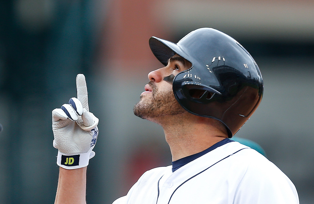 . Detroit Tigers\' J.D. Martinez celebrates a single against the Oakland Athletics in the fourth inning of a baseball game in Detroit, Thursday, April 28, 2016. (AP Photo/Paul Sancya)