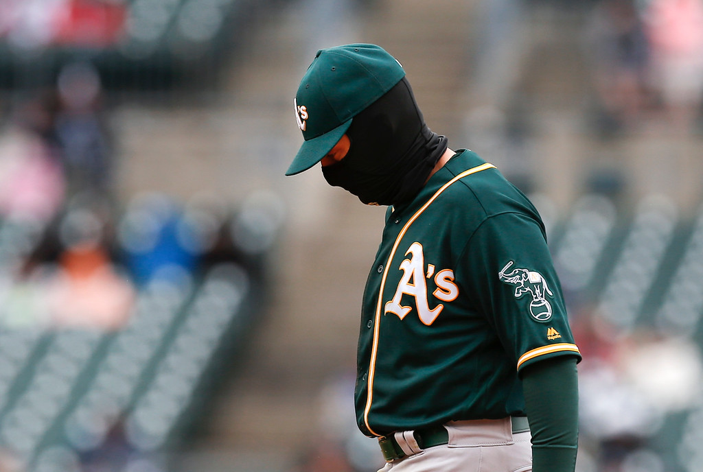 . Oakland Athletics second baseman Jed Lowrie wears a Balaclava against the Detroit Tigers in the seventh inning of a baseball game in Detroit, Thursday, April 28, 2016. (AP Photo/Paul Sancya)