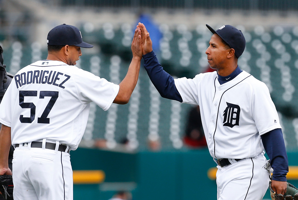 . Detroit Tigers relief pitcher Francisco Rodriguez (57) congratulates Anthony Gose after beating the Oakland Athletics 7-3 in a baseball game in Detroit, Thursday, April 28, 2016. (AP Photo/Paul Sancya)