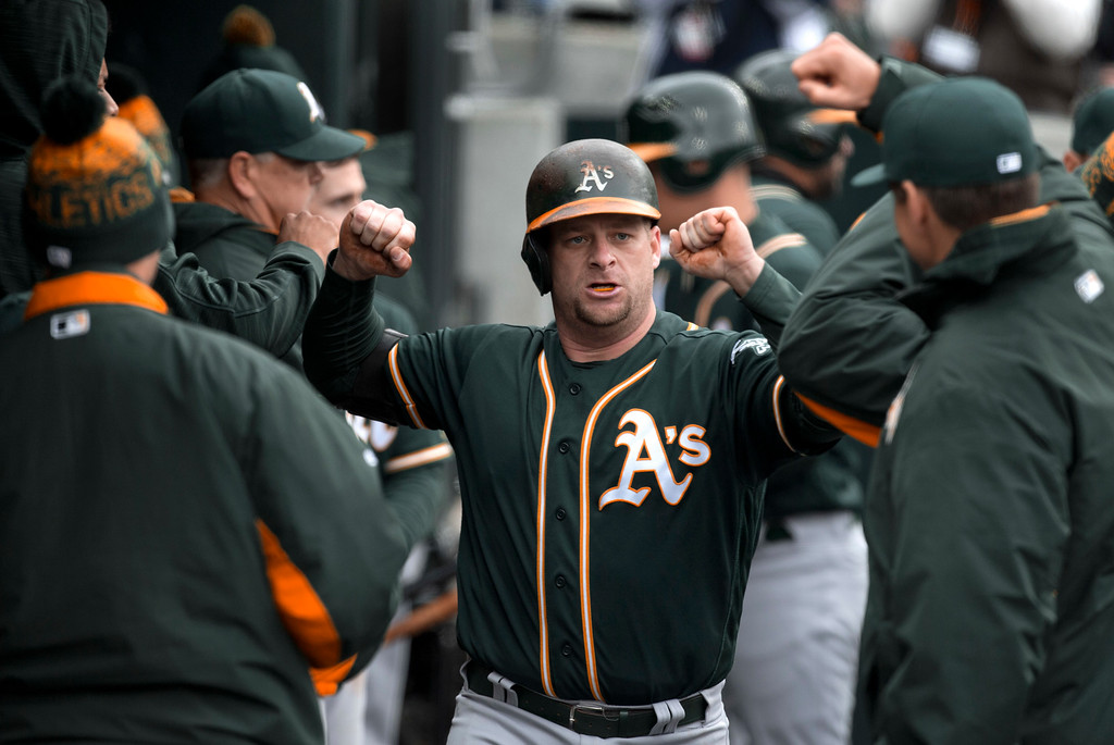 . Oakland Athletics\' Stephen Vogt celebrates after hitting a solo home run against the Detroit Tigers in the fourth inning of a baseball game in Detroit, Thursday, April 28, 2016. (AP Photo/Paul Sancya)