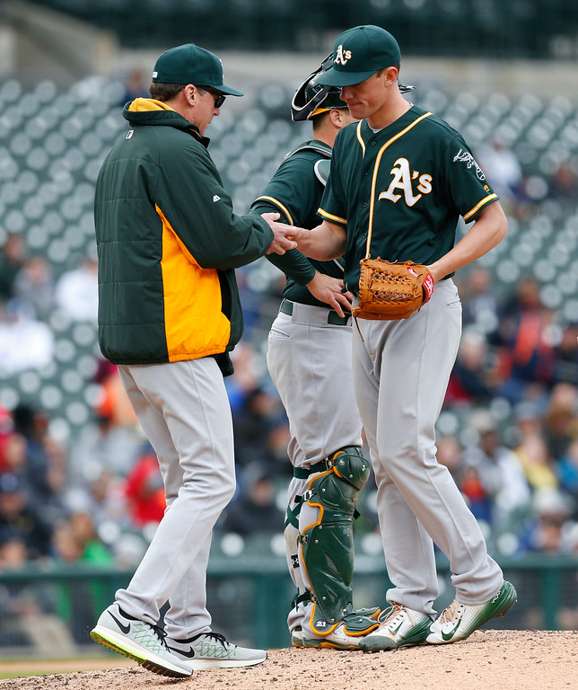 . Oakland Athletics manager Bob Melvin takes the ball from pitcher Chris Bassitt in the fourth inning of a baseball game against the Detroit Tigers in Detroit, Thursday, April 28, 2016. (AP Photo/Paul Sancya)
