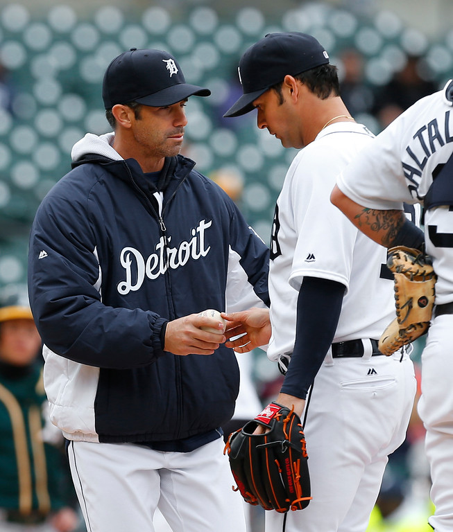 . Detroit Tigers manager Brad Ausmus takes the ball from pitcher Anibal Sanchez in the sixth inning of a baseball game against the Oakland Athletics  in Detroit, Thursday, April 28, 2016. (AP Photo/Paul Sancya)
