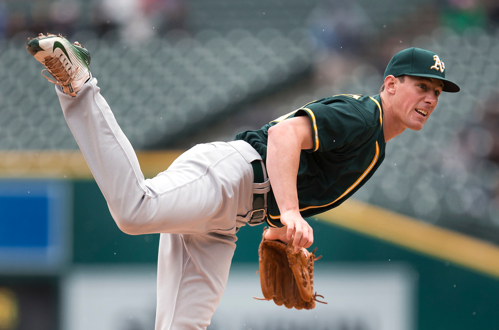 . Oakland Athletics pitcher Chris Bassitt throws against the Detroit Tigers in the first inning of a baseball game in Detroit, Thursday, April 28, 2016. (AP Photo/Paul Sancya)