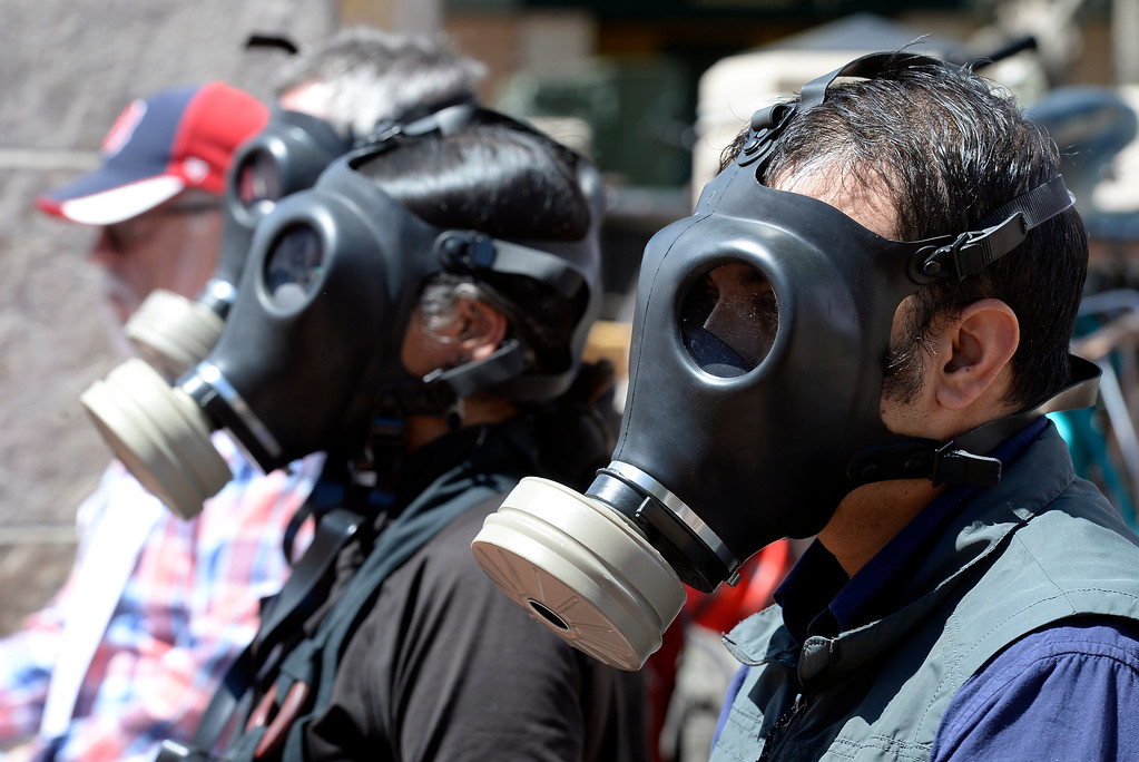 . Imtiaz Rangwala, at right, wears a gas mask while meditating with gas masks on during a anti-fracking protest on Monday at the Boulder County Courthouse on the Pearl Street Mall in Boulder, Colo. For more photos and video of the fracking protest go to www.dailycamera.com Jeremy Papasso/ Staff Photographer/ May 1, 2017