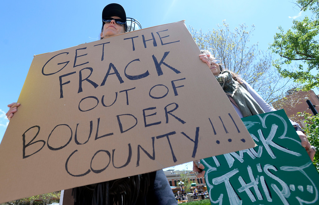. Jen Markus, of Boulder, holds a sign during a anti-fracking protest on Monday at the Boulder County Courthouse on the Pearl Street Mall in Boulder, Colo. For more photos and video of the fracking protest go to www.dailycamera.com Jeremy Papasso/ Staff Photographer/ May 1, 2017
