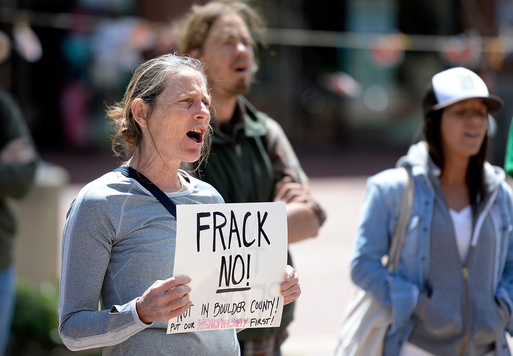 . Sola DiDomenico, of Boulder, holds a sign and chants with others during a anti-fracking protest on Monday at the Boulder County Courthouse on the Pearl Street Mall in Boulder, Colo. For more photos and video of the fracking protest go to www.dailycamera.com Jeremy Papasso/ Staff Photographer/ May 1, 2017