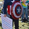 "Man in ""Captain America"" costume listens to a speaker at an anti-fracking rally at the State Capitol in Denver."