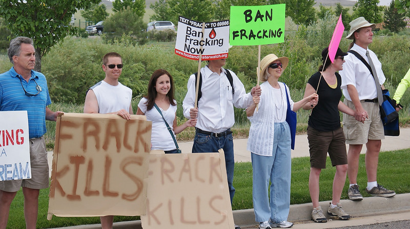 Fracking opponents in a line, holding hands.