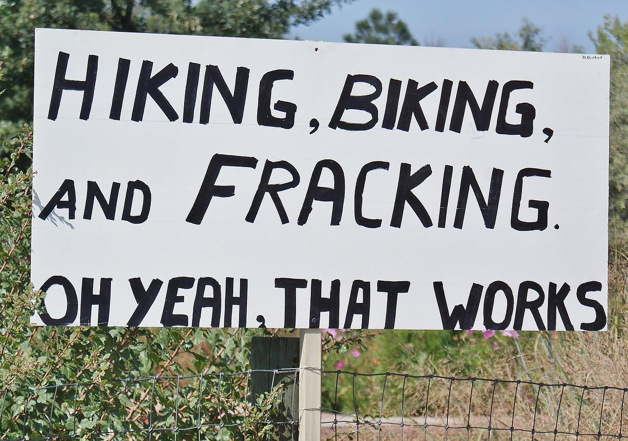 Anti-fracking sign about hiking and biking.