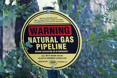 Natural gas pipeline warning sign near fracking site, near Lafayette, in Boulder County, Colorado.