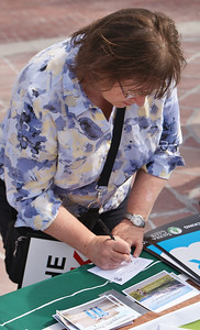 Woman signing petition against fracking, at protest in Boulder,Colorado.