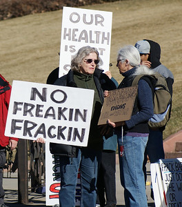 "Fracking opponents with signs including ""No Freakin Frackin""."