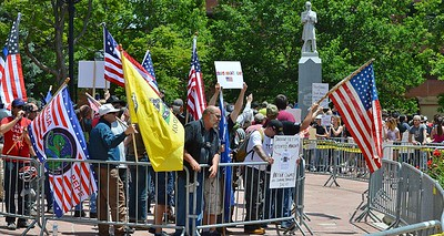 """Members of the alt-right group """"The Proud Boys"""" and counter demonstrators face off with each other across barricades set up by  the police at a rally in Boulder, Co."""