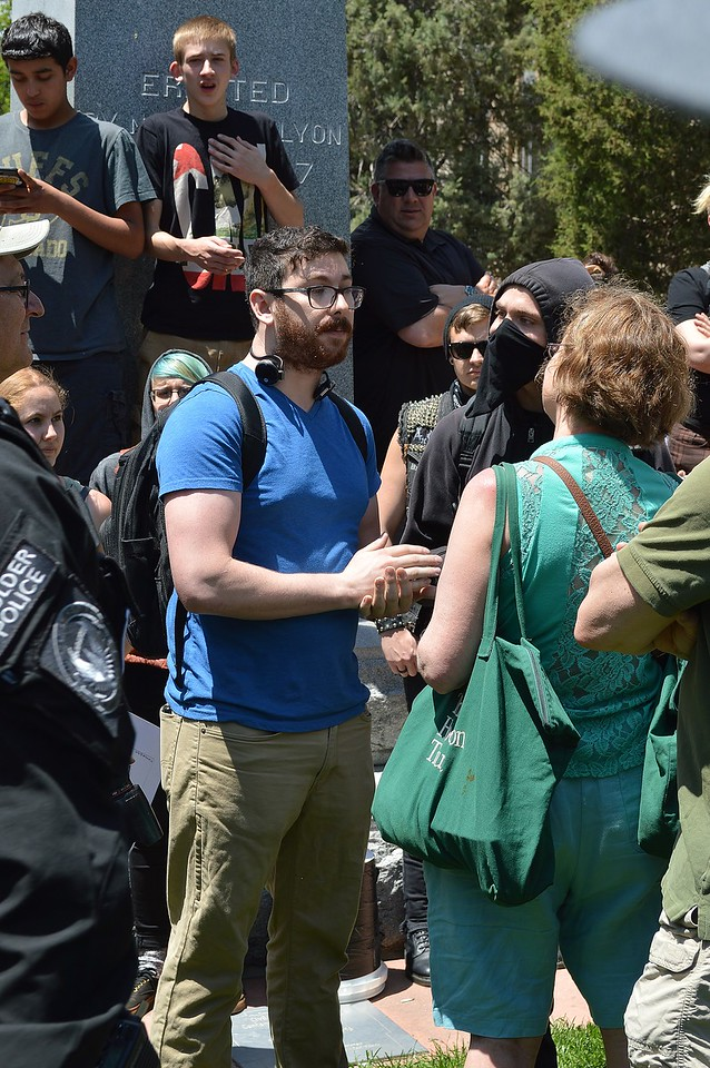 """Supporters and opponents of the alt-right group """"The Proud Boys"""" having a discussion at a rally in Boulder, Co."""