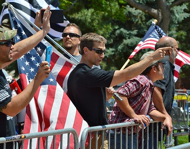"""This member of the alt-right group """"The Proud Boys"""" gestures and exchanges words with counter protesters at a rally in Boulder, Co."""