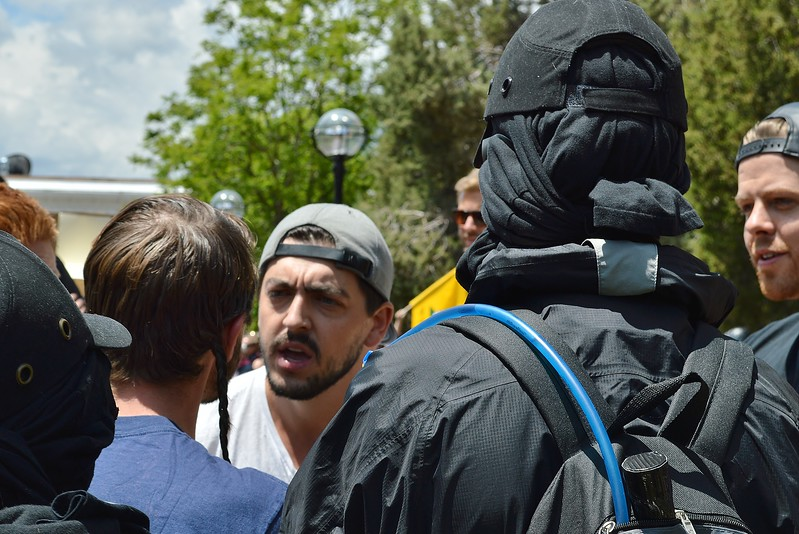"Supporters and opponents of the alt-right group ""The Proud Boys"" having a discussion at a rally in Boulder, Co."