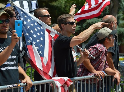 "This member of the alt-right group ""The Proud Boys"" gestures and exchanges words with counter protesters at a rally in Boulder, Co."