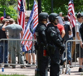 "Police in Boulder Colorado, some in riot gear, keep watch at a rally held by the alt-right group ""The Proud Boys"", which drew about 300 counter protesters."